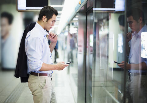 Man looking at website on a smartphone
